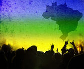 Crowd and Brazil flag — Stock Photo