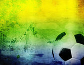 Football and the brazil flag's colours — Stock Photo