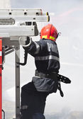 Firefighter in action — Stock Photo