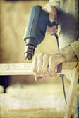 Man's arms drill lath — Stock Photo