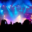 Crowd and stage lights at concert — Stock Photo