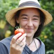 Stock Photo: Woman with tomato