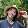 Woman with tomato — Stock Photo