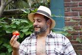 Man looking at his tomato — Stock Photo