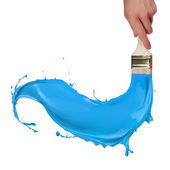 Colored paints splashing out of brush — Stock Photo