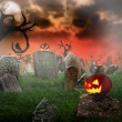 Cemetery with glowing pumpkins - Stock Photo