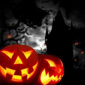 Glowing pumpkins in a dark — Stock Photo