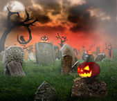 Cemetery with glowing pumpkins — Stock Photo
