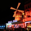 The Moulin Rouge by night - Stockfoto