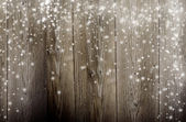 Old wooden background with falling snow flakes — Stock Photo
