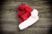 Santa cap on wood — Stock Photo