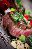 Bloody bbq steak — Stock Photo
