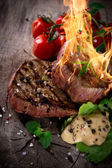 Bloody bbq steaks — Stock Photo