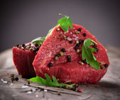 Raw beef steaks — Stock Photo