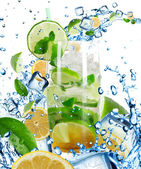 Mojito Cocktail with splashing liquid — Stock Photo