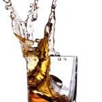 Whiskey splash with ice cubes — Stock Photo