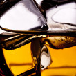 Whiskey splash with ice cubes — Stock Photo #20757583