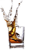 Whiskey splash with ice cubes — Stock Photo