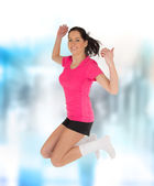 Fitness woman jumping — Stock Photo