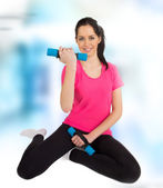 Fitness woman lifting weights — Stock Photo