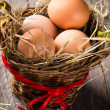 Eggs in brown basket — Stock Photo