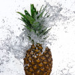 Pineapple with water splash — Stock Photo #22239621