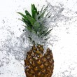 Pineapple with water splash - Stock Photo