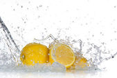 Lemon with water splash — Stock Photo