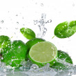 Limes with water splash — Stock Photo