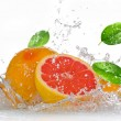 Royalty-Free Stock Photo: Grapefruit with splashing water
