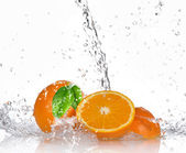 Oranges with splashing water — Stock Photo