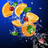 Fresh oranges and cherries in water splash — Stock Photo
