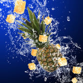 Pineapple with water splash — Stock Photo