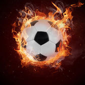 Hot soccer ball in fires flames — Stock Photo