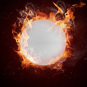 Hot ping-pong ball in fires flames — Stock Photo