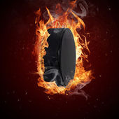 Hot hockey puck in fires flame — Stock Photo
