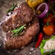 Delicious beef steaks — Stock Photo #24435121