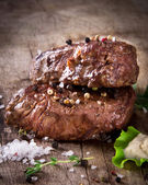 Delicious beef steaks — Stock Photo