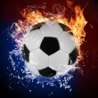 Soccer ball in fire flames and splashing water — Stock Photo