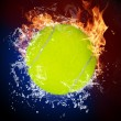Tennis ball in fire flames and splashing water - Foto Stock