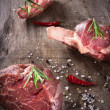 Raw beef steaks - Photo