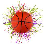 Colorful splashing with basketball — Stock Photo