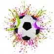 Colorful splashing with soccer ball — Stock Photo