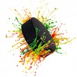 Colorful splash with hockey puck — Stockfoto