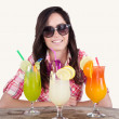 Portrait of a beautiful young girl with cocktail — Stock Photo