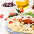 Penne with tomatoes — Stock Photo