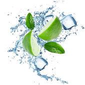 Limes and Splashing water — Stock Photo