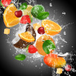 Fruit with splashing water — Stock Photo #29065093