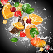 Fruit with splashing water — Stock Photo