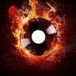 Stock Photo: Burning vinyl disc